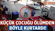 İzmir Buca'da caddeye atlayan çocuğu son anda kurtardı!